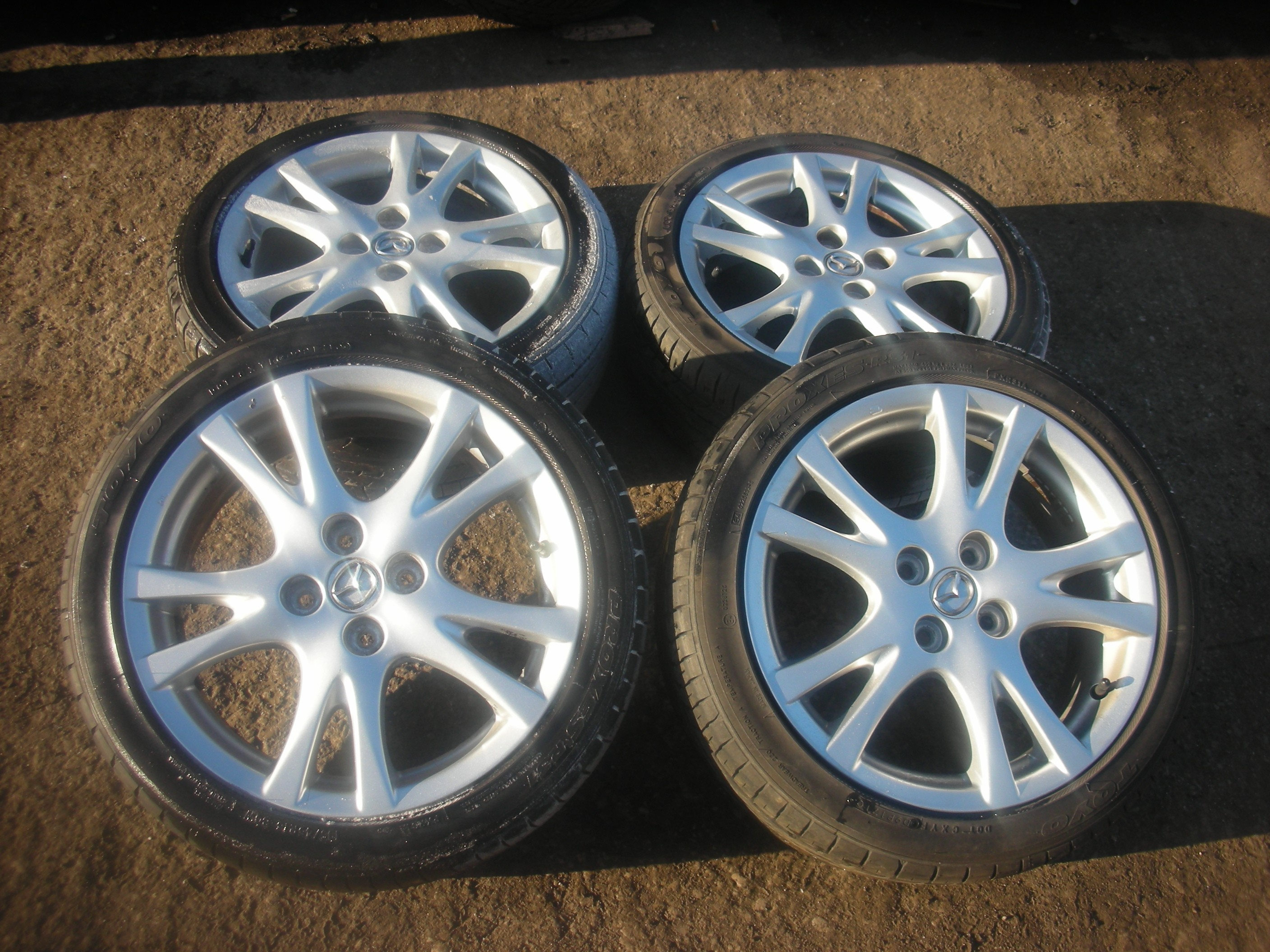 "ORIGINAL SET OF 4 MAZDA 2 16"" ALLOY WHEELS AND TYRES 09 SPORT."